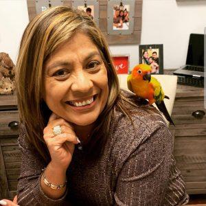 Headshot of Maria Hernandez in her office