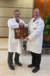 Dr. Ralph Kruse (right) was recently presented a plaque recognizing his election as a Fellow of the International College of Chiropractors by Dr. Michael Wiles, Dean of Keiser University's College of Chiropractic Medicine.
